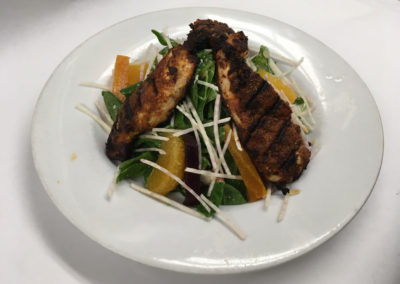 Grilled Cajun Chicken over Caesar Salad